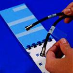 Brady M-32-427 Black on Clear / White Vinyl Die-Cut Thermal Transfer Printer Cartridge - 1.5 in Width - 1/2 in Height - B-427